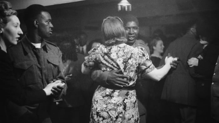 A black GI dancing with a white woman at the Bouillabaisse Club in London, July 17, 1943.