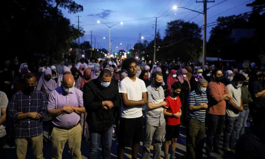 People pray following a vigil after four members of a Muslim family were killed in what police describe as a hate-motivated attack at London Muslim Mosque in London, Ontario.
