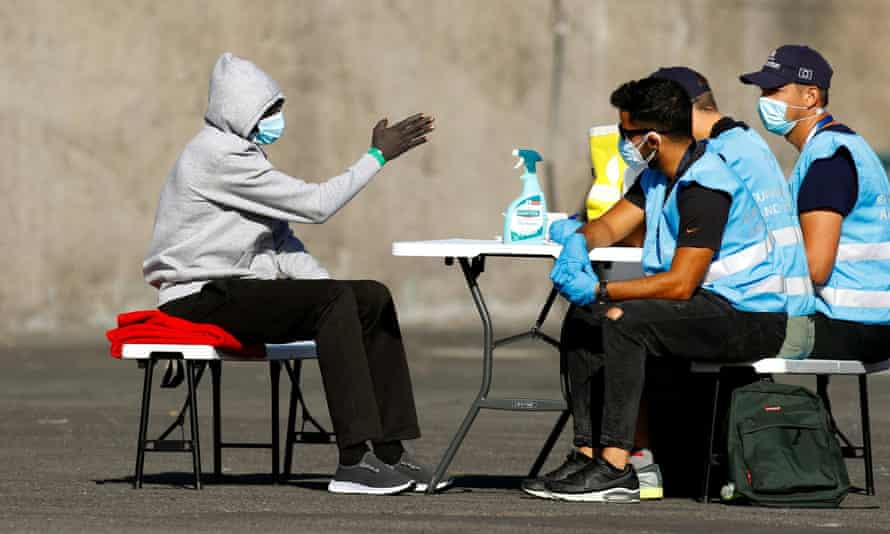 A migrant is interrogated by Frontex officials on the Spanish island of Gran Canaria.
