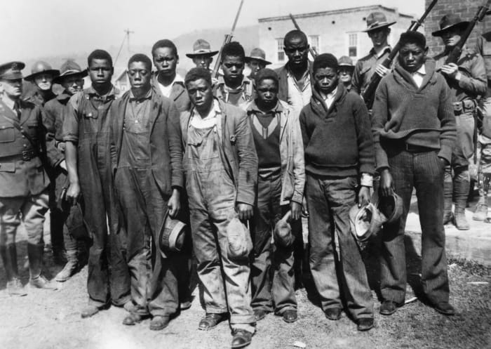The accused Scottsboro Boys (left to right): Clarence Norris, Olen Montgomery, Andy Wright, Willie Roberson, Ozie Powell, Eugene Williams, Charlie Weems, Roy Wright, and Haywood Patterson.