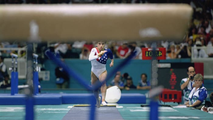 Kerri Strug ATLANTA - JULY 23: Kerri Strug of the United States throws herself onto the track as she competes in the vault, part of the women's team gymnastics competition at the 1996 Olympic Games on July 23, 1996 at the Georgia Dome in Atlanta, Georgia