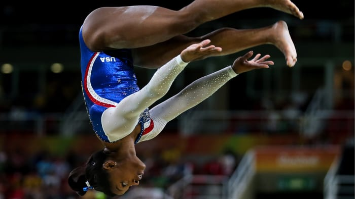 RIO DE JANEIRO, BRAZIL - AUG 11, 2016: Simone Biles of the United States performs her routine during the final round of the artistic gymnastics women's all-around at the 2016 Summer Olympic Games in Rio de Janeiro, Brazil, at the Rio Olympic arena.