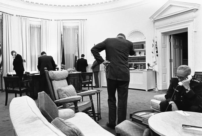 President Lyndon B. Johnson and his advisers meet in the Oval Office to communicate with Federal troops sent to quell race riots in Detroit and to plan their handling of the crisis.  1967.