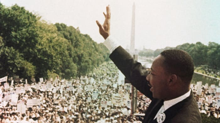 Martin Luther King, Jr. waves to the crowd during the March on Washington on August 28, 1963, where he gave his famous