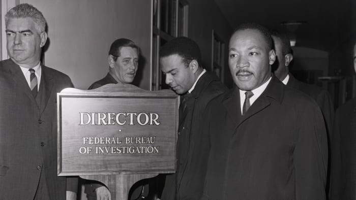 Martin Luther King Jr. arriving at the Federal Bureau of Investigation to speak with director J. Edgar Hoover, who had publicly called the civil rights leader