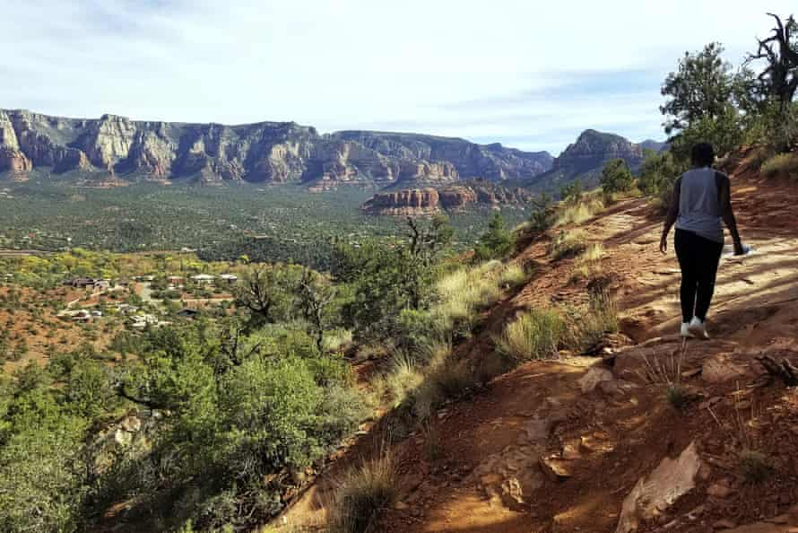 A visitor walks a trail in the Coconino national forest in Sedona, Arizona.