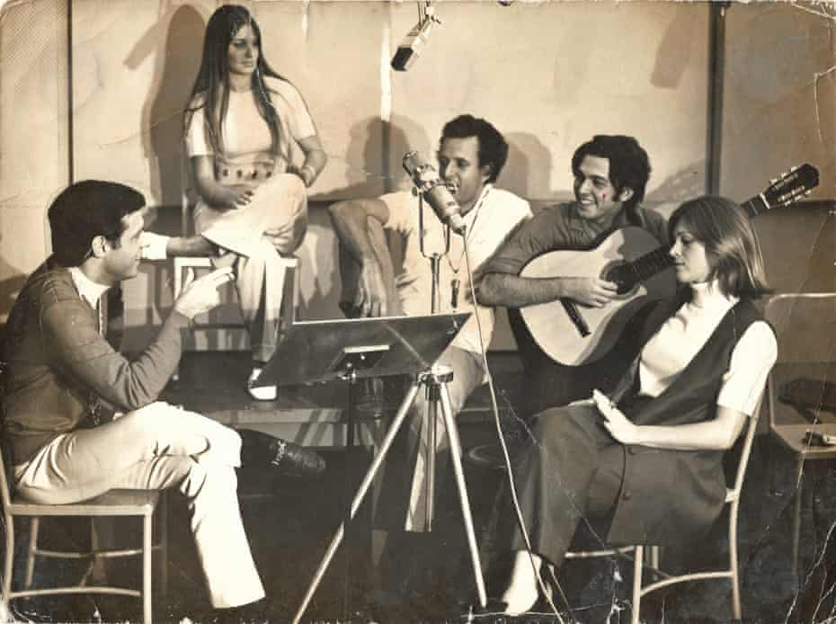 Quartin, left, and Mauro, second right, with friends after a recording session.