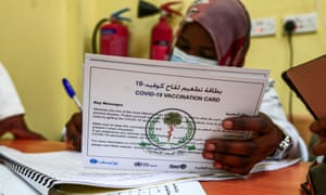 A medical worker prepares vaccination card for a person receiving a dose of the Oxford-AstraZeneca vaccine in Sudan's capital Khartoum. Sudan was the first in the Middle East and North Africa to receive vaccines through Covax, a UN-led initiative that provides jabs to poor countries