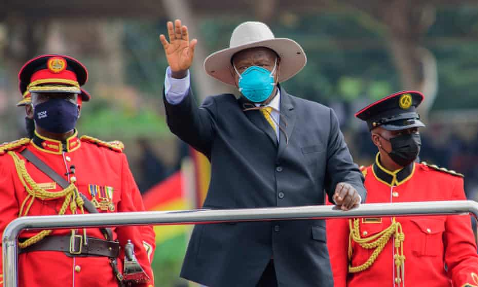 Yoweri Museveni waves during the inauguration ceremony for his sixth term as president of Uganda in Kampala on 12 May.