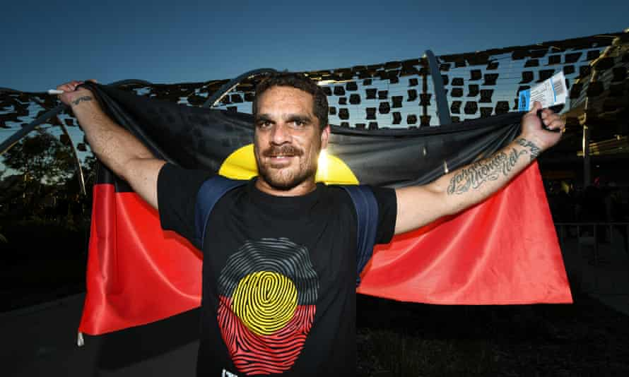 A fan in support of the Long Walk and Dreamtime match between Essendon and Richmond at Perth's Optus Stadium.