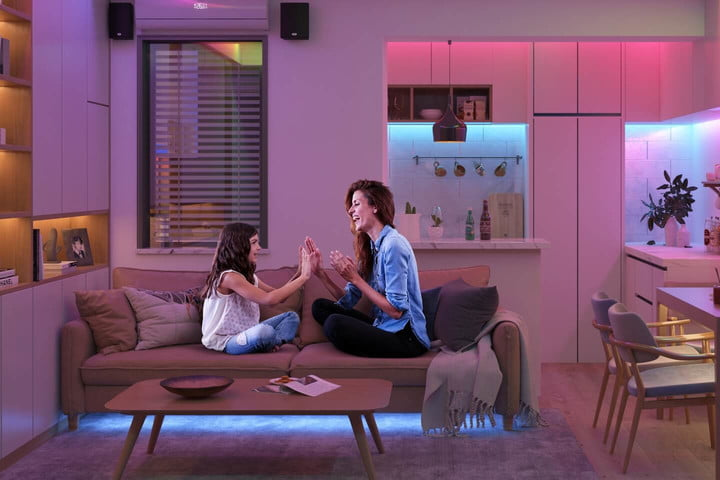 Mother and daughter in living room with Govee lights on.