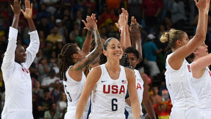 US goalie Sue Bird reacts as US players celebrate the United States' victory over Spain in a women's gold medal basketball match between the United States and Spain at Carioca Arena 1 in Rio de Janeiro on August 20, 2016 during the Rio 2016 Olympic Games.