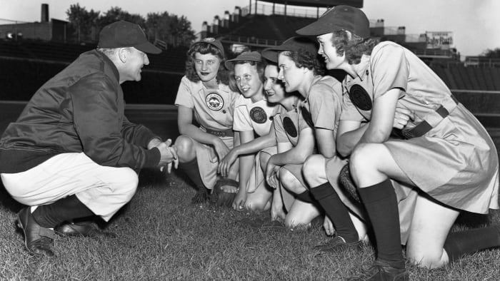 Members of the All-American Girl's Professional Baseball League's Rockford Peaches reunite with their coach, Eddie Stumpf, during training in May 1944.