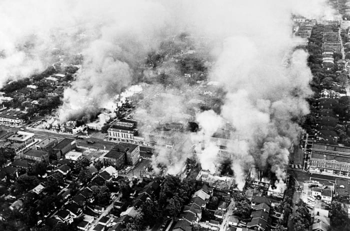 Aerial view of buildings on fire in Detroit on July 25, 1967 during riots that broke out in Detroit following a police operation
