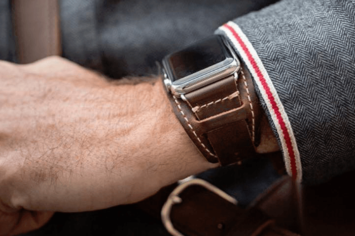 A person wearing the Pad & Quill Lowry Leather Cuff.