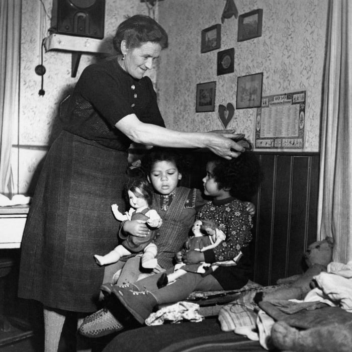 A German Caring for Two German Mixed-Breed Children, c.  1950s.