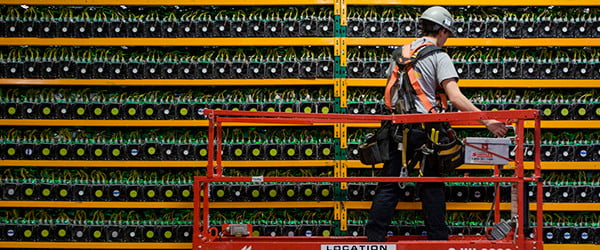 A cryptocurrency mining operation with rows of GPUs.