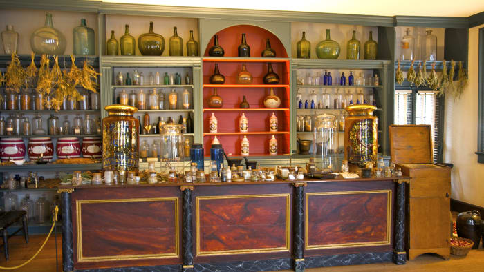 Original shelves, drawers and lockers with leeches, lancets and snake from a colonial-era apothecary in Fredericksburg, Virginia.