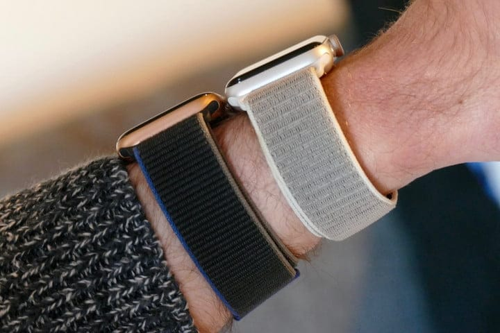 Showing two different Apple Watch bands on wrist.