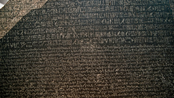 The Rosetta Stone was discovered in 1799 and featured writing in three different scripts: hieroglyphic, demotic, and ancient Greek.