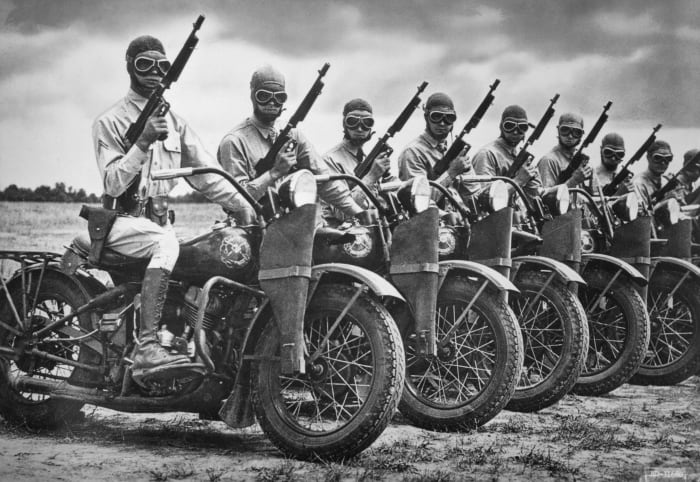 The Harley-Davidson Motor Co. built over 90,000 motorcycles during World War II for the United States military.  A row of mounted soldiers from the Army's Armored Division put on an impressive spectacle.
