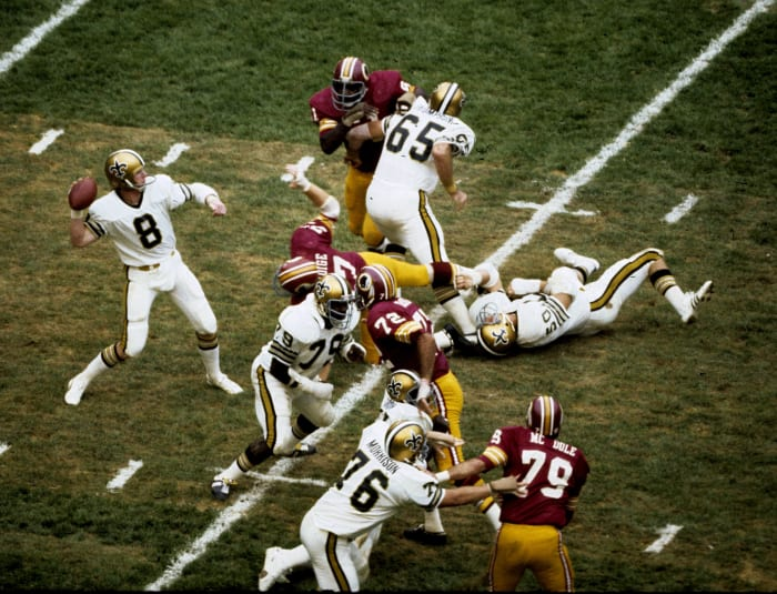 New Orleans Saints quarterback Archie Manning appears to pass in a 41-3 loss to the Washington Redskins on September 21, 1975 at RFK Stadium in Washington, DC (Photo by Nate Fine / Getty Images)