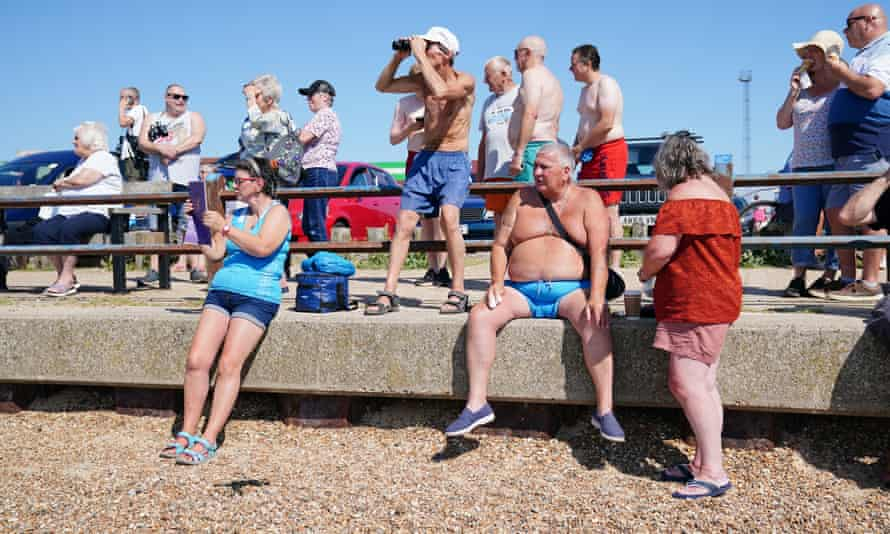 People watch the Ever Given arrive at the Port of Felixstowe in Suffolk