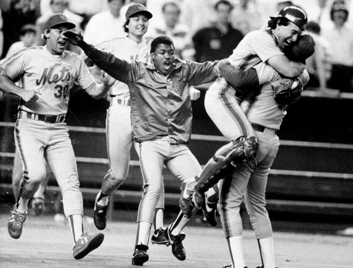 Receiver Gary Carter jumps into the arms of pitcher Jesse Orosco after the Mets claim the National League pennant.