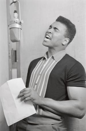 """In 1964. Muhammad Ali records a rhythm and blues album, """"The whole gang is there."""""""