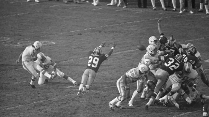 In Super Bowl VII against Washington, Garo Yepremian's placement attempt was blocked. The kicker picked up the ball and threw it, but the ball was caught by Mike Bass, who returned it for a touchdown.