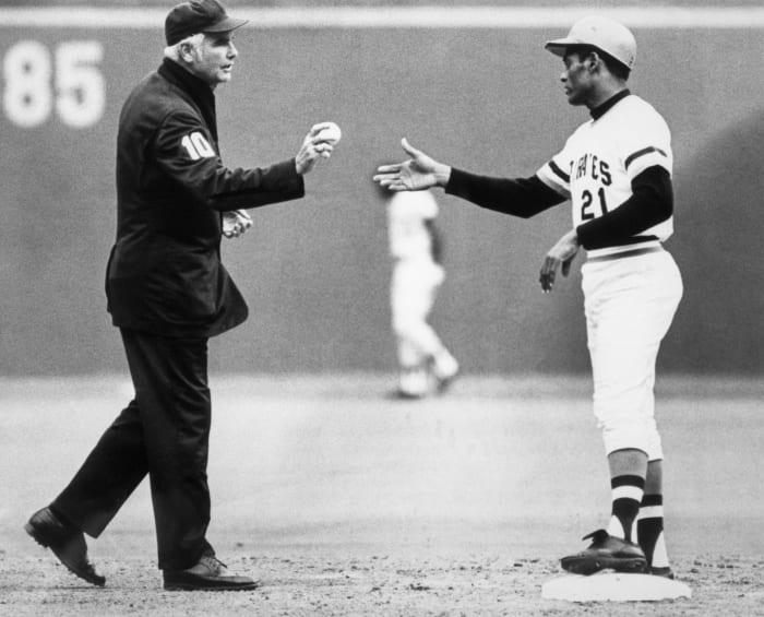 Referee Doug Harvey hands Roberto Clemente his 3,000th batted ball.