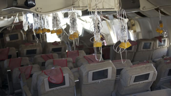 Oxygen masks hang from the ceiling inside the cabin of Asiana Airlines Flight 214 following a crash on July 6, 2013 in San Francisco, California. Asiana Airlines' Boeing 777 from Seoul, South Korea, crashed on the runway at San Francisco International Airport.