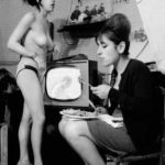 A Soho strip club dressing room, with Wimbledon tennis on the television, 1965.