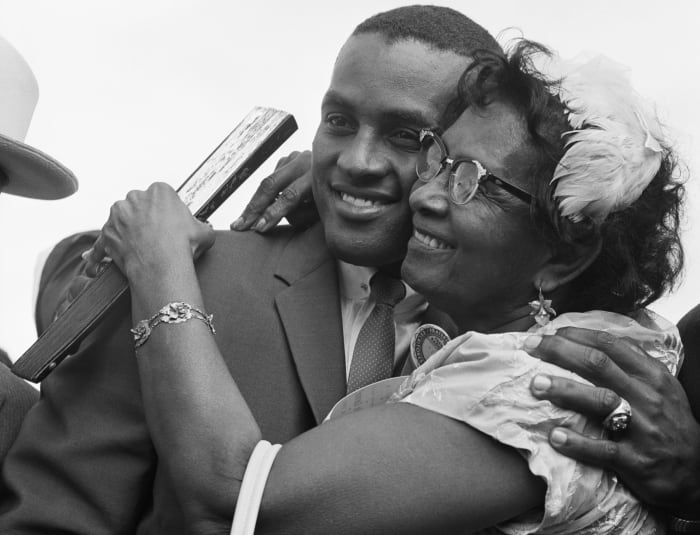 Roberto Clemente hugged his mother at the San Juan airport in 1961, the year he won the National League batting title.