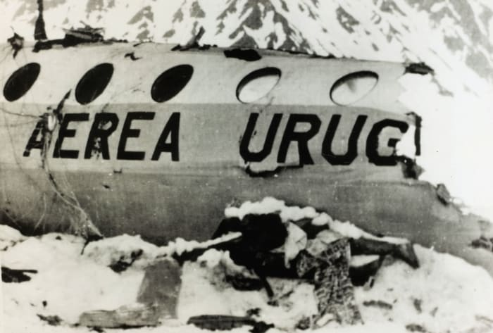 A corpse from the Andean air disaster lies near the wreckage.