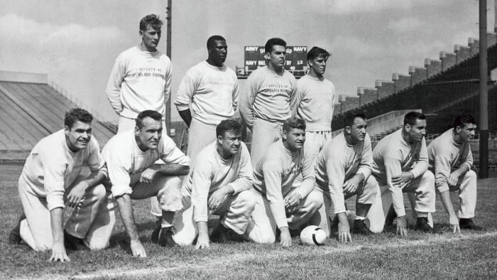 Stars of the 1950 Cleveland Browns included quarterback Otto Graham (second from right, back row) and running back Marion Motley (back row, second from left).