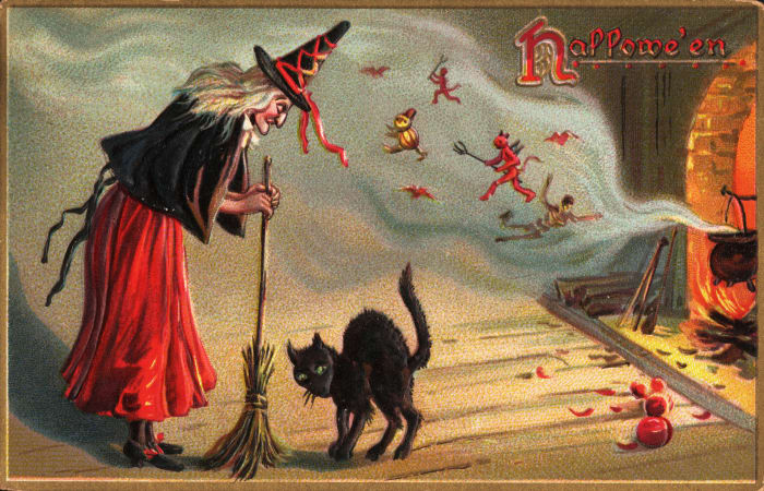 An early 1900s Halloween postcard featuring a witch, black cat, and spirits.